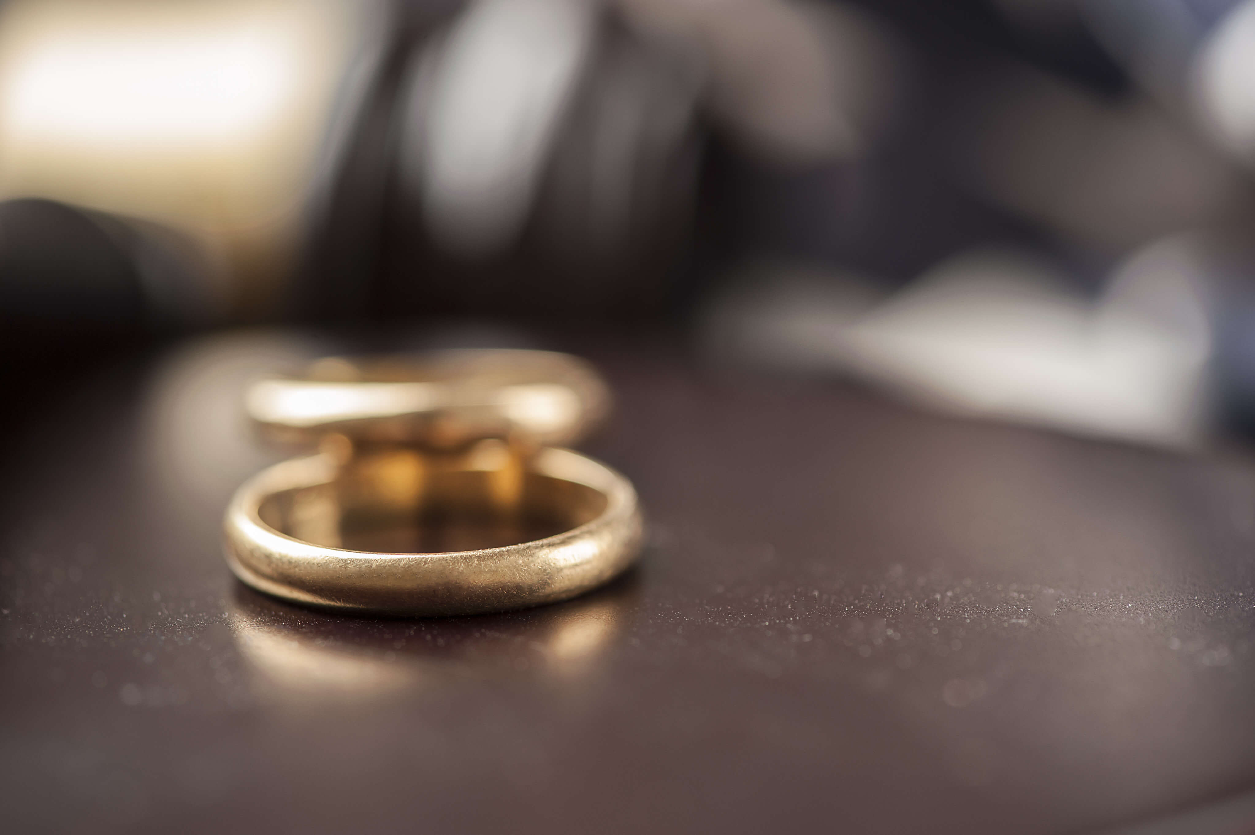 weddings rings placed on a desk at a divorce law firm on Long Island